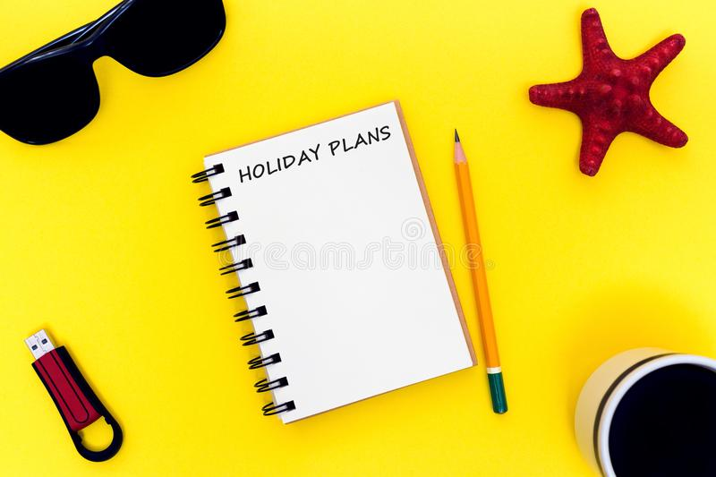 Bright workspace with notebook, coffee, glasses, flash drive and starfish. Creating a summer mood and a desire to live stock photography