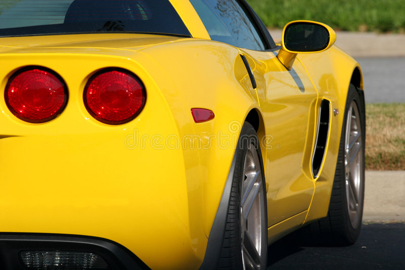 Bright Yellow Car. Rear view of a bright yellow sports car stock photography
