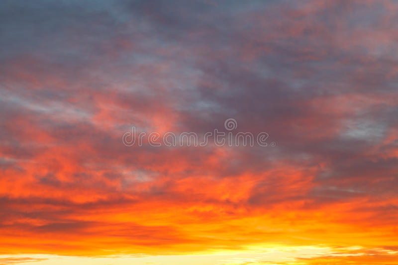 Download Bright Yellow Clouds Under Blue Sky In Sunrise Stock Image - Image: 35396619