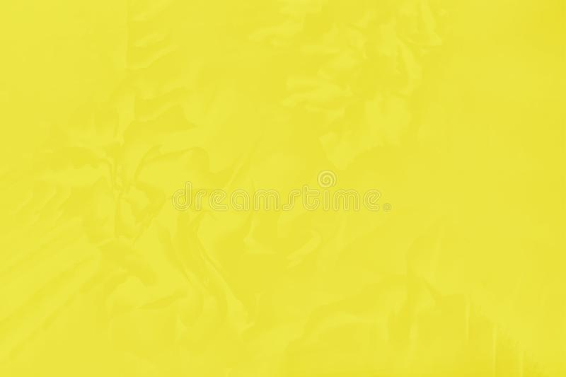 Beautiful bright yellow color with a delicate floral pattern royalty free stock photos
