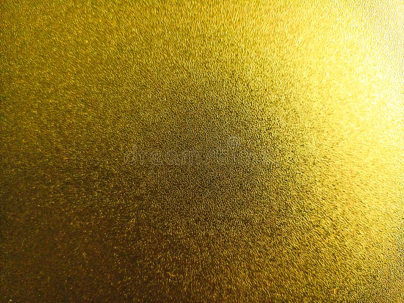 Bright yellow coloured shiny background with light and dark light effects,attractive wallpaper royalty free stock image
