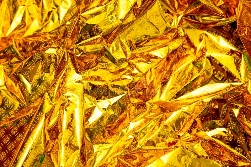 Bright yellow holographic foil background. Multicolor trendy. Bright yellow holographic foil background royalty free stock photo