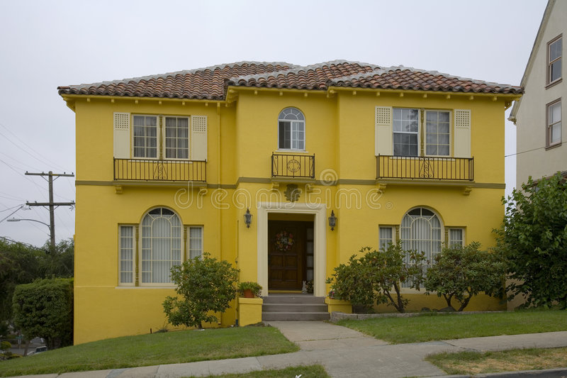 Bright Yellow House stock images