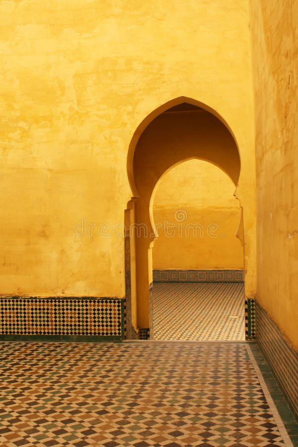 Bright yellow islamic arches and patios in Meknes, Morocco. Bright yellow islamic arches patios and islamic art in Meknes, Morocco royalty free stock photography