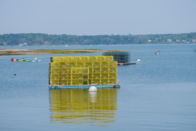 Bright Yellow lobster cages sit on a loading platform in Wills G stock photo