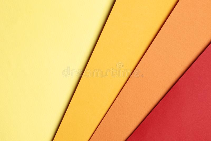 Bright yellow, orange and red abstract blank paper background stock image