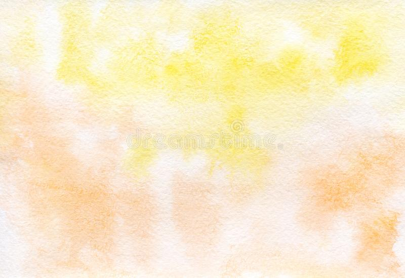 Yellow-orange watercolor background painted by hand royalty free stock photo