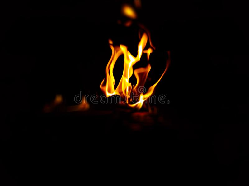 Yellow and red fire with black background. A bright Yellow and red Fire with black background stock photography