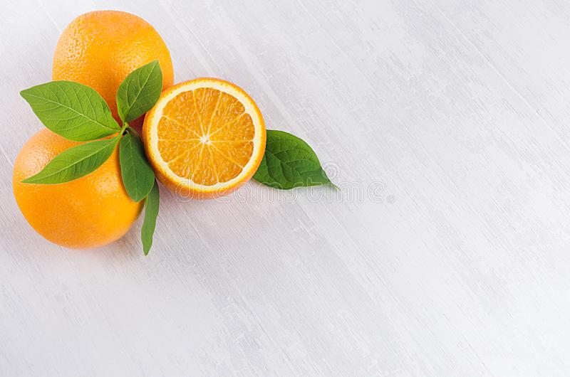 Bright yellow ripe juicy oranges on white wood table, top view, copy space. stock photo