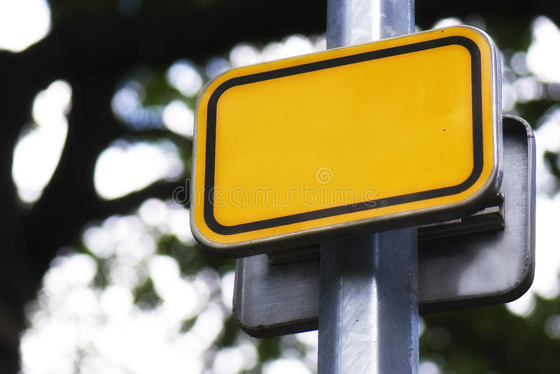 Bright yellow road sign stock photos