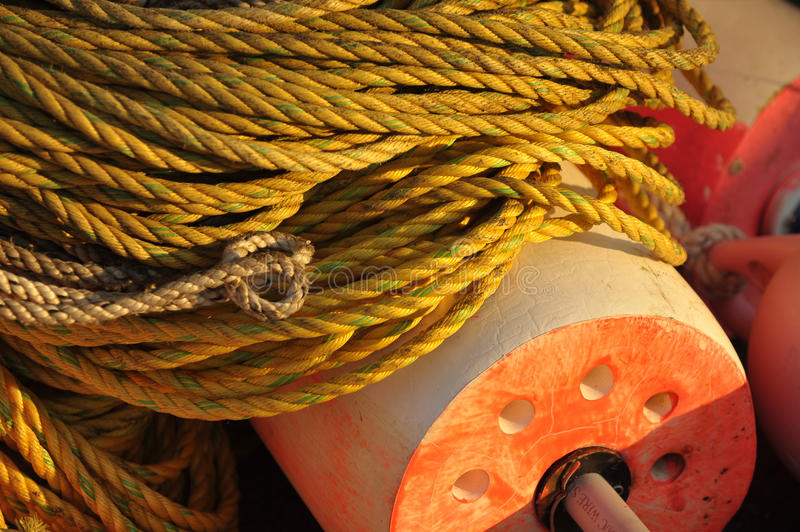 Bright Yellow Rope and Lobster Float stock image