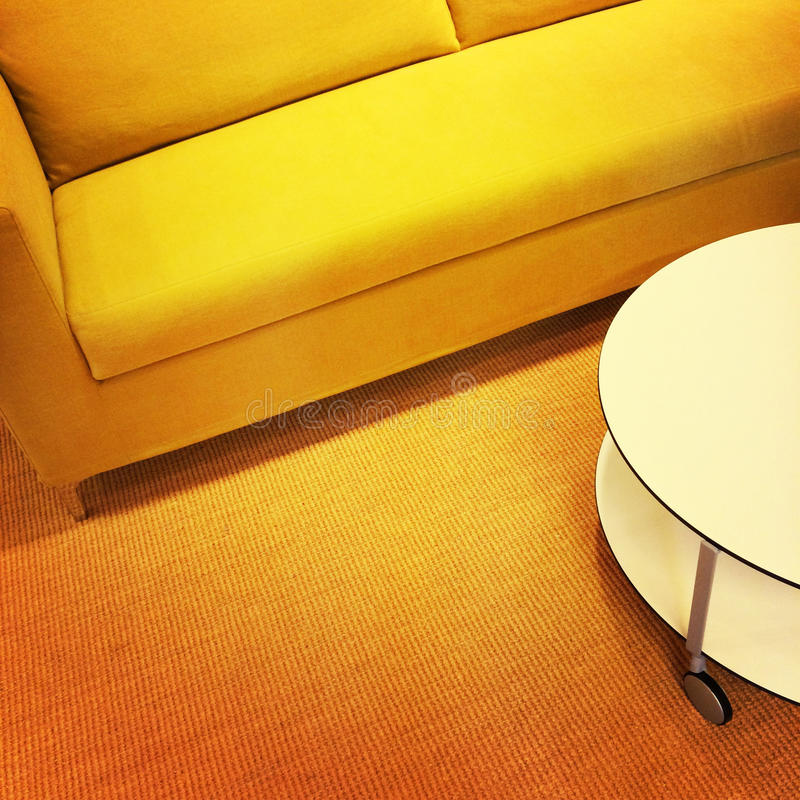 Bright yellow sofa and coffee table stock photo image for Sofa table yellow