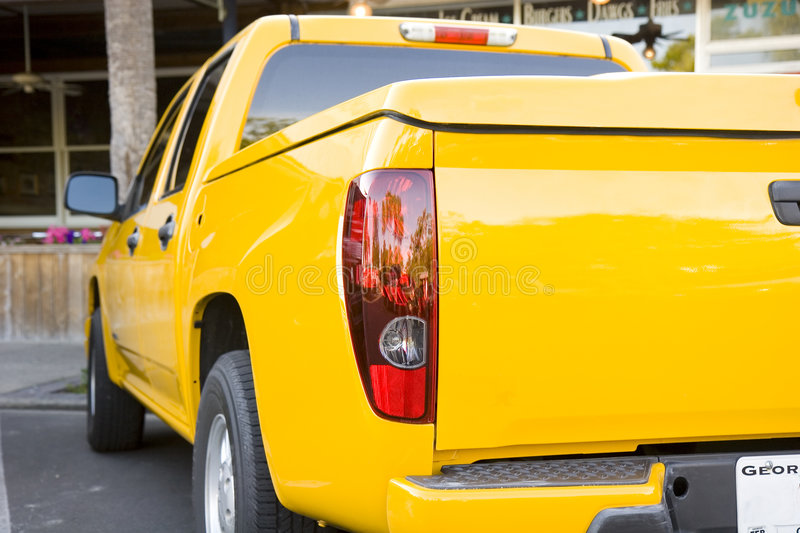 Bright Yellow Sports Truck. The rear of a bright yellow sports truck or wagon stock photography