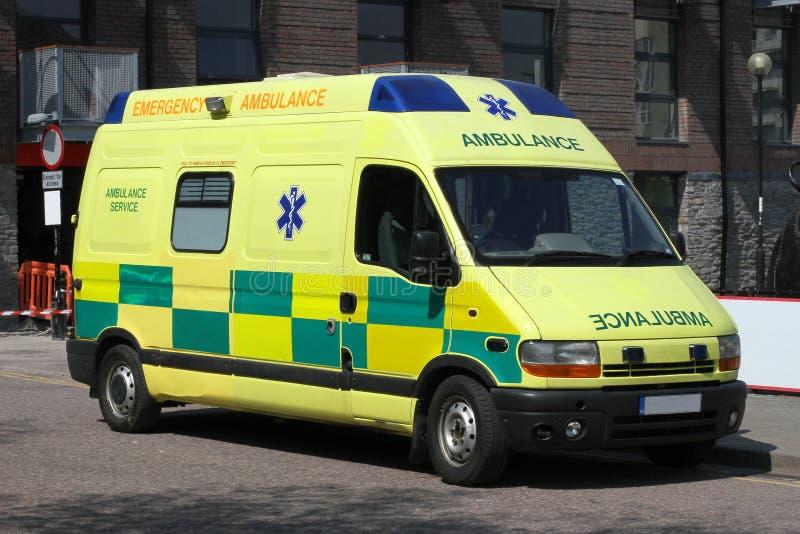 Bright yellow UK Ambulance. Parked on the street stock image