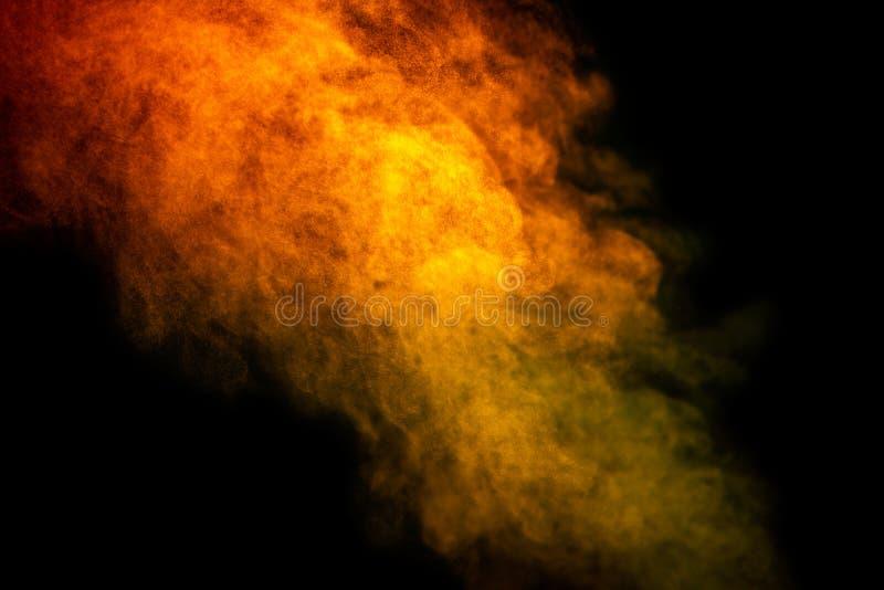 Bright yellow vapor isolated on black background is macro. Smoke, steam, mist, effect, design, fog, light, cloud, white, shape, magic, swirl, air, pattern stock photography