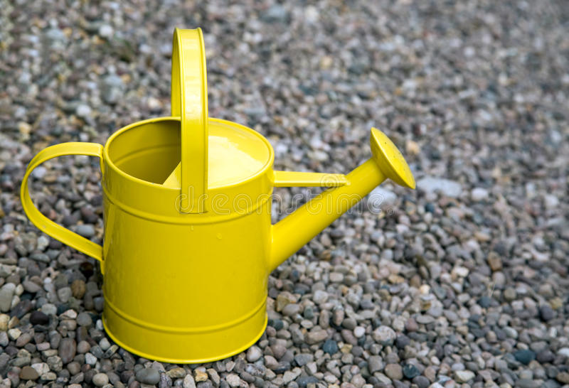 Bright yellow watering can royalty free stock photos