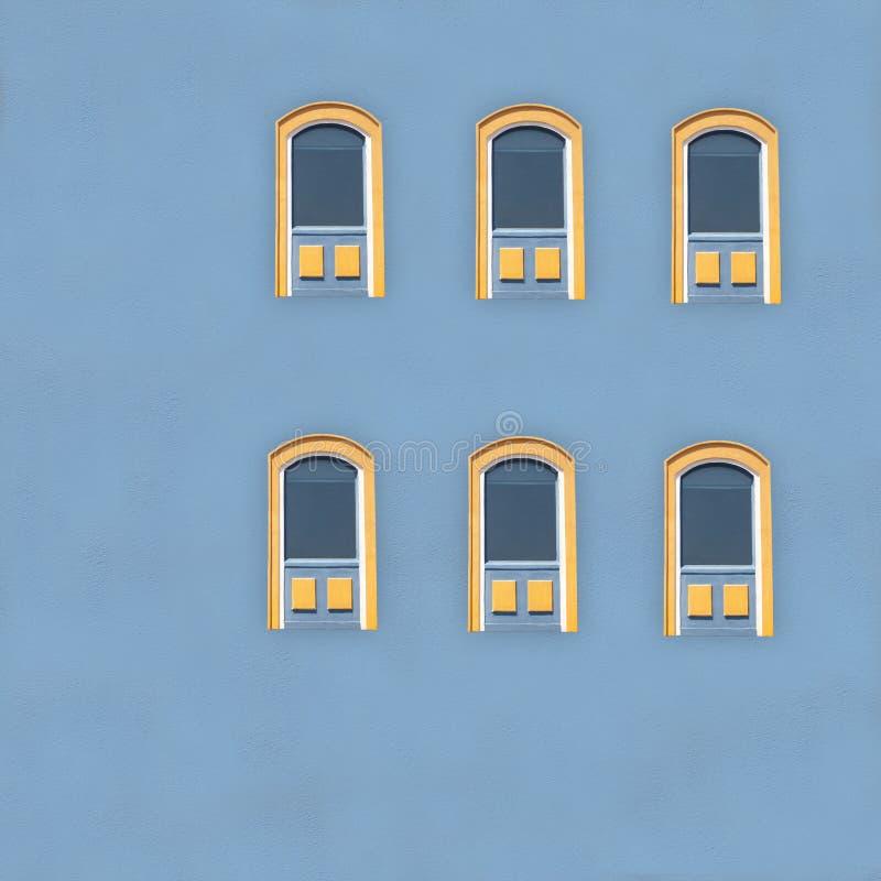 Bright Yellow Windows on Blue stock photo