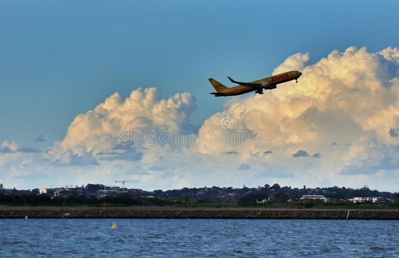 Brighten Le Sands Beach-A plane that takes off at sea stock photos