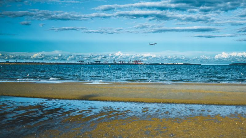 Plane over Sydney-Above Brighten le sands Beach. AT Brighten le sands, you can see planes taking off here royalty free stock image