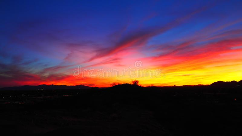 Brighten My Night. Is a presentation of the beautiful colors of the evening sky as the y are being displayed ay the desert sunset of arizona usa. Vgphotoz royalty free stock photography