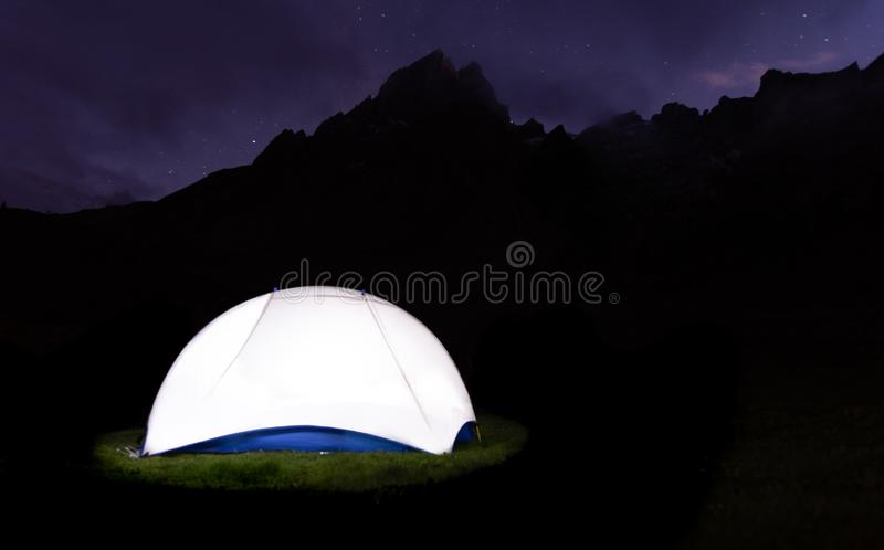 bright tent infront of mountain stock photo