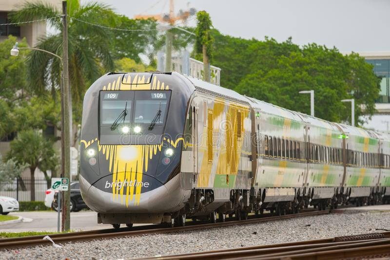 Brightline high speed train departing Fort Lauderdale FL stock images