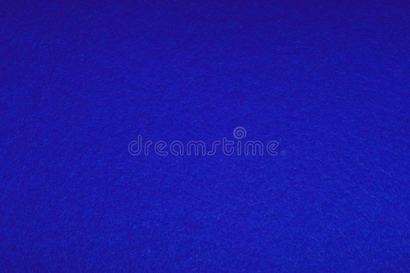 Brightly blue colored felt - background. soft fluffy texture. Abstract art background. Empty space. stock images