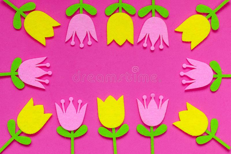 Brightly colored felt tulip flowers on a plain background stock photo
