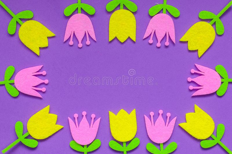 Brightly colored felt tulip flowers on a plain background stock photos