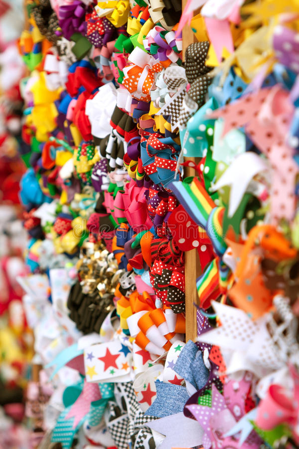 Download Brightly Colored Hat Ribbons Fill Wall Stock Photography - Image: 25249852