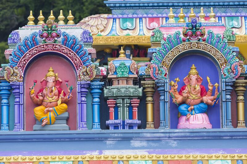 Brightly colored Hindu-themed statues outside of Batu Caves. In Kuala Lumpur, Malaysia royalty free stock image