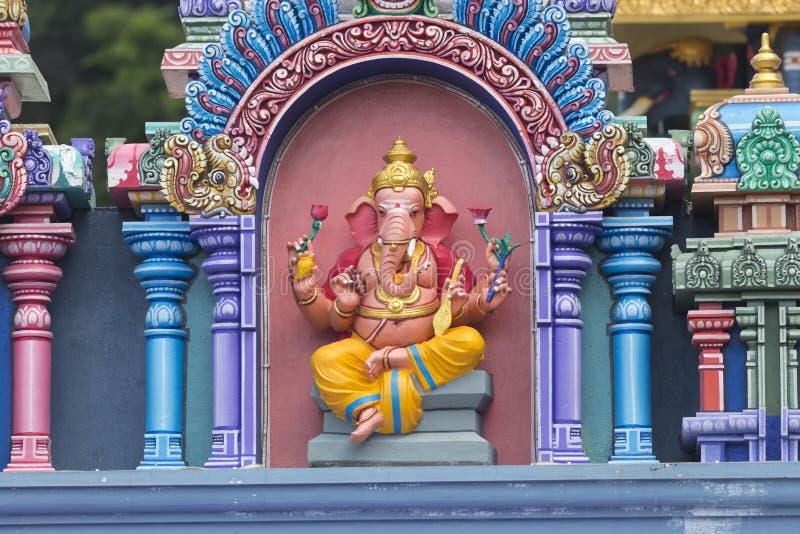 Brightly colored Hindu-themed statues outside of Batu Caves. In Kuala Lumpur, Malaysia stock image