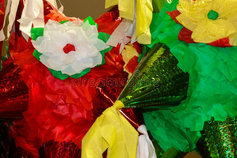 Brightly colored piñata ready to fill with candy and small toys for a Mexican celebration - Background - Closeup. A Brightly colored piñata ready to fill royalty free stock photography