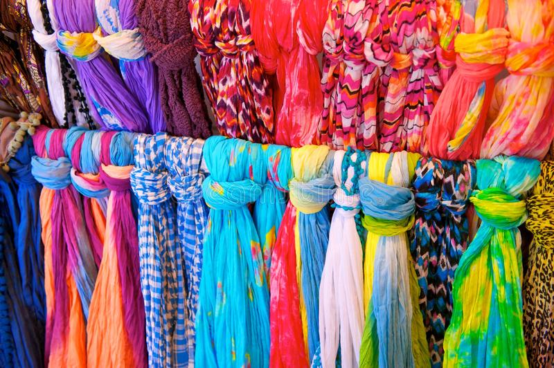 Brightly Colored Scarves on Rack stock photography