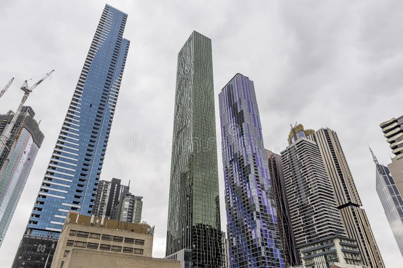 Brightly colored skyscrapers in central Melbourne, Australia, against a cloudy sky royalty free stock images