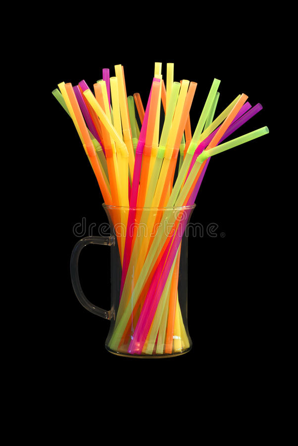 Brightly colored straws isolated on black royalty free stock images