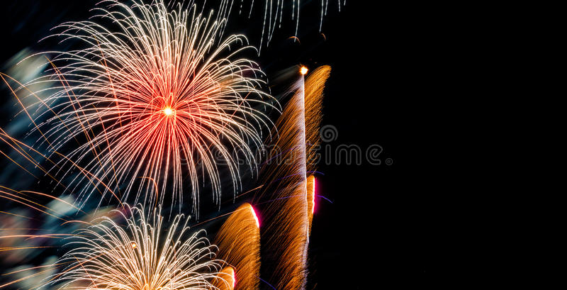 Brightly Colorful Fireworks on dark sky background royalty free stock photo