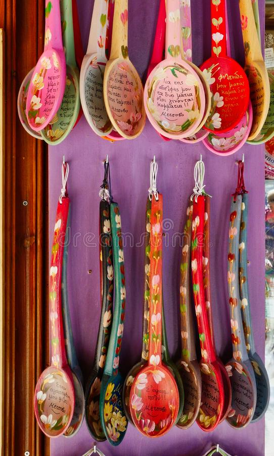 Colourful Souvenir Wooden Spoons, Metsovo, Epirus, Greece. Brightly coloured and painted wooden spoons, with Greek alphabet writing including village name stock image