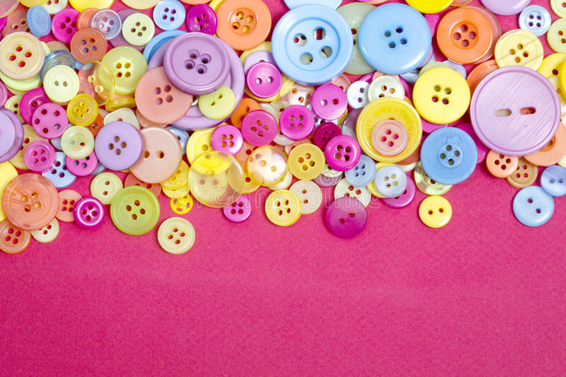 Brightly coloured retro and vintage plastic buttons. Collection of a range of different coloured buttons for a poster or web background royalty free stock image