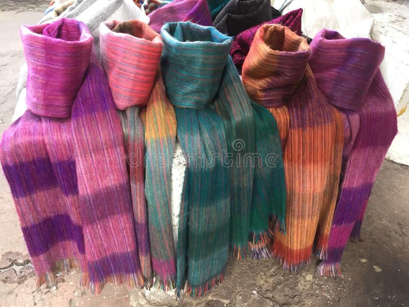 Brightly coloured scarfs for sale at the famous market otavalo in ecuador royalty free stock photography