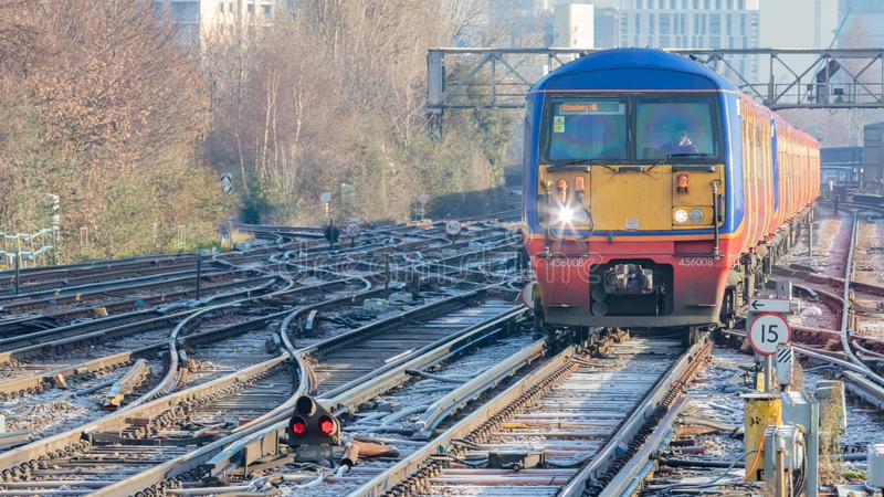 Brightly Coloured Train. Multiple Train Tracks royalty free stock image