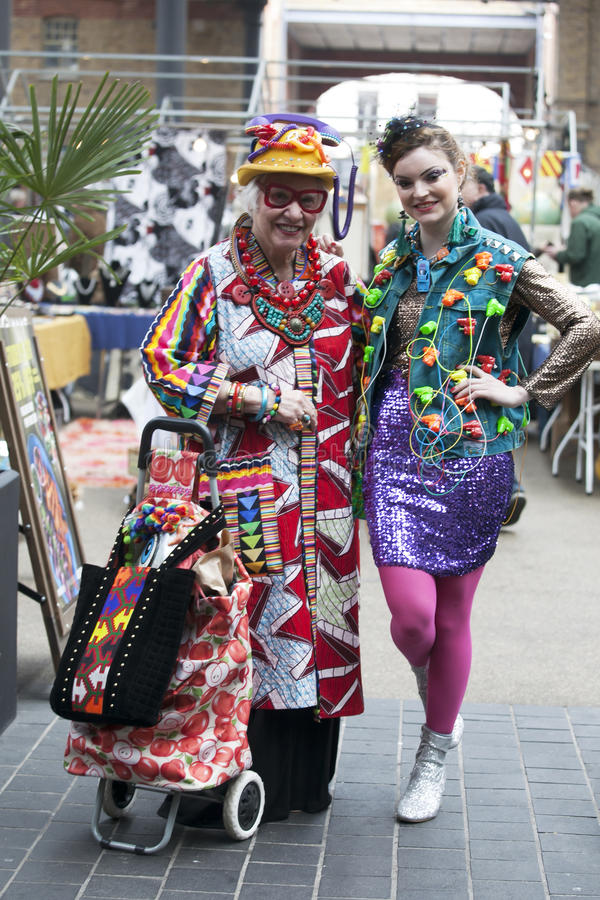 Brightly dressed women in typical East London style on Brick Lan royalty free stock photography