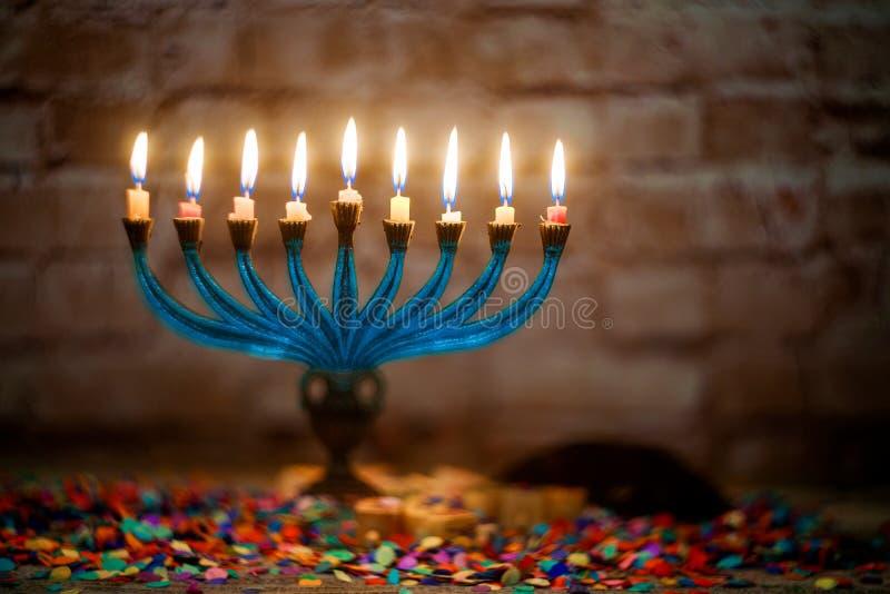 Brightly Glowing Hanukkah Menorah soft focus royalty free stock photo