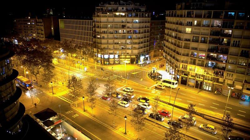 Brightly illuminated street at night, cars waiting at traffic lights, bus lane. Stock footage royalty free stock image