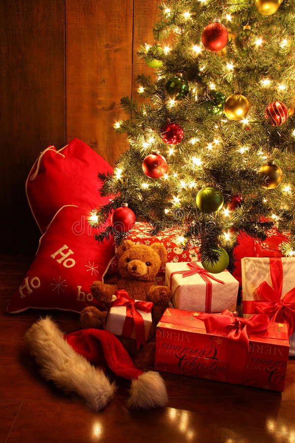 Brightly lit Christmas tree with gifts royalty free stock photo