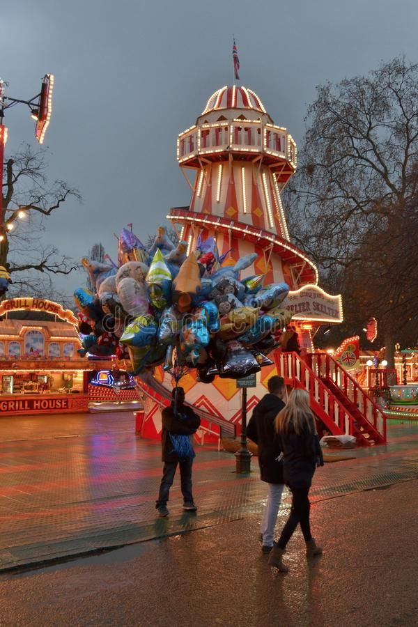 Brightly lit colourful fairground helter skelter royalty free stock images