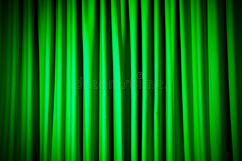 Brightly lit curtains stock images