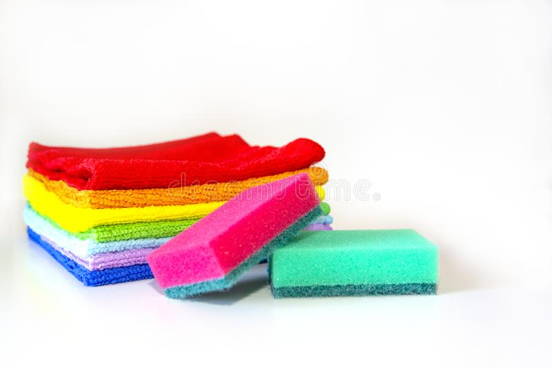 Brightly multicolored cleaning sponges and rags on white background royalty free stock photography