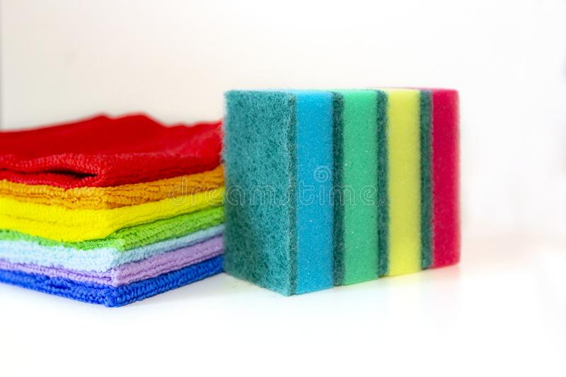 Brightly multicolored cleaning sponges and rags on white background.  royalty free stock photos