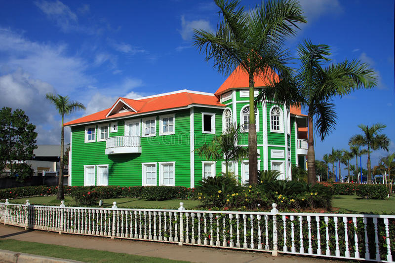 Brightly painted green clapboard building royalty free stock images